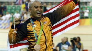 Bronze medalist Azizulhasni Awang of Malaysia poses on the podium of the men's keirin cycling final at the Rio Olympic Velodrome during the 2016 Summer Olympics in Rio de Janeiro, Brazil, Tuesday, Aug. 16, 2016. (AP Photo/Patrick Semansky)